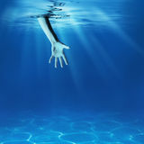 Problem solving concept. Giving helping hand underwater. Problem solving concept. Giving helping hand in sea underwater stock photography