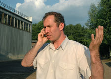 Problem talking. A man having problem talking after working time Royalty Free Stock Photo