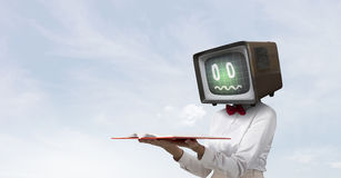Problem of television addiction. Mixed media Stock Photography
