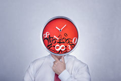 Problem with time. Businessman with a creative clock which imitates his head. Bad organisation and time management concept Royalty Free Stock Images