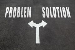 Problem vs solution choice concept. Two direction arrows on asphalt Royalty Free Stock Photography