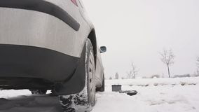 Problem winter launch of a diesel car, freezing of poor-quality diesel fuel and a weak battery, slow motion, breakage. Transportation stock video