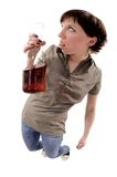 Problem of woman alcoholized. Drunk young woman with bottle of red wine Royalty Free Stock Images