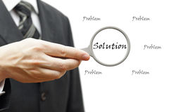 Problema y solución - concepto del negocio con el hombre de negocios y el mag Imagen de archivo