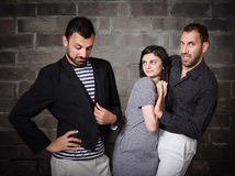 Problemas divertidos del threesome Foto de archivo
