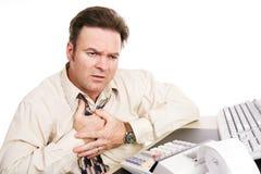 Problemas financieros - ataque de la indigestión o del corazón imágenes de archivo libres de regalías