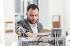 Problemas novos da fixação do coordenador com a impressora 3D Imagens de Stock