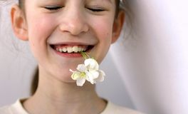 Problematic teeth in a young beautiful girl. Curve row reason to visit the dentist and orthodontist stock photo