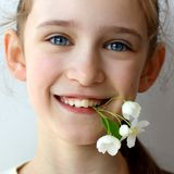 Problematic teeth in a young beautiful girl. Curve row reason to visit the dentist and orthodontist stock image