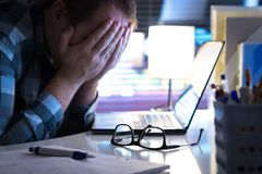 Free Problems At Work. Sad, Unhappy And Tired Man Covering Face. Stock Photography - 109925412