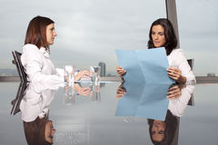 Problems with bank loan. Woman having problems with the bank loan stock image