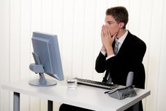 Problems with computer viruses and spam at. A man has problems with computer viruses and spam at the office Stock Photos