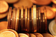 Problems of economic crisis and the need to save. Euro coins scene expressing the problems of economic crisis and the need to save Royalty Free Stock Photo