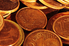 Problems of economic crisis and the need to save. Group of euro coins highlighting the texture and shine Stock Photo
