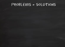 Problems equal solutions. A blackboard or chalkboard message Problems = Solutions Stock Image
