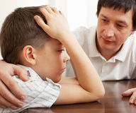 Problems in the family. Father comforts a sad child. Problems in the family Stock Image