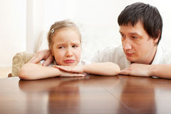 Problems in the family. Father comforts a sad girl. Problems in the family Stock Photography