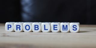 Problems. Letter cube wordings on wood background stock image