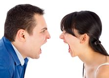 Problems in relationships. Young couple nervously shouting at each other Stock Photos