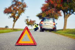 Problems on the road. Sad man having car trouble on the country road Royalty Free Stock Image