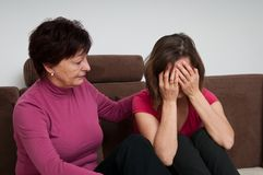 Problems - senior mother comforts daughter Stock Image