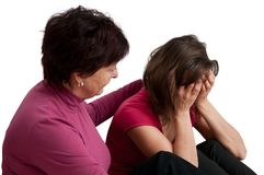 Problems - senior mother comforts daughter Stock Photo