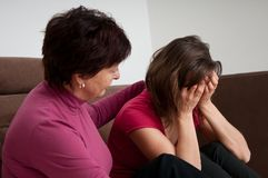 Problems - senior mother comforts daughter Royalty Free Stock Image