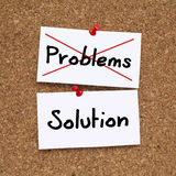PROBLEMS SOLUTION. Problems crossed - Solution written notes pinned on cork noticeboard Stock Image