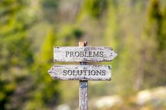 Free Problems Solutions Text Carved On Wooden Signpost Outdoors In Nature Stock Photos - 192481283