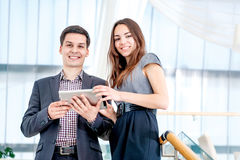 Problems solved! A young man and young woman Stock Photos