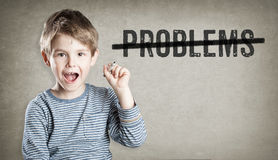 Problems striked through, Boy on grunge background writing Stock Photos