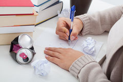 Problems in studying. Math student having problems in an exercise Royalty Free Stock Image