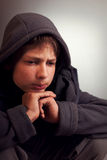 Problems of teenagers, Sad child sitting in a dark room thinks Royalty Free Stock Images