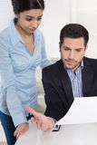 Problems at work: Boss criticizes his female colleague and blame. Her because of her mistakes Royalty Free Stock Images