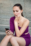 Problems - young woman with phone Royalty Free Stock Photos