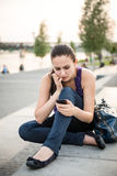 Problems - young woman with phone Royalty Free Stock Images