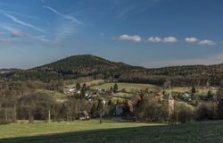 Probostov village in spring sunny day. In Ceske Stredohori mountains royalty free stock photos