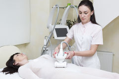 The procedure of lipomassage in a beauty salon. Makes a woman stock photo