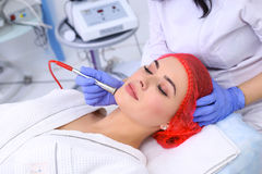Procedure of Microdermabrasion. Mechanical Exfoliation, diamond polishing. Model, close-up. Cosmetological clinic Medical equipment Royalty Free Stock Photo