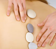 Procedure with pebbles at spa Stock Image