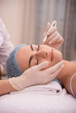 Procedure of professional cosmetology skin care Stock Images