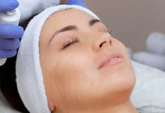 The procedure of steaming the skin of the face of a young woman before cleaning the skin royalty free stock images