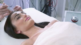 Procedure of ultrasonic face treatment at beauty spa stock footage