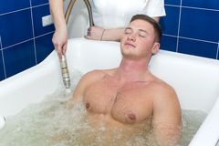 Procedure in the whirlpool hydrobath Stock Images