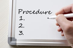 Procedure written on whiteboard Stock Image