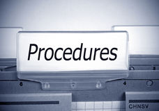 Procedures folder in the office Stock Photo