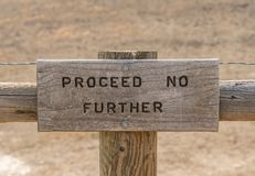 Proceed No Further Sign. At the end of a trail stock photography