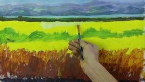 Proceso creativo del arte El artista crea la pintura en lona almacen de metraje de vídeo