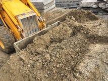 Proceso de la excavación en sitio fotos de archivo