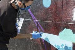 Proceso de la pintura de la pintada detalles Fotografía de archivo